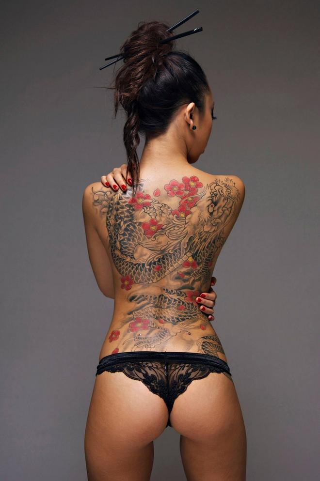 Asian girl with dragon tattoo