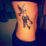 Female Tattoo 12 150x150 - 100's of Female Tattoo Design Ideas Pictures Gallery