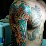 Tiger and Dragon 7 150x150 - 100's of Tiger and Dragon Tattoo Design Ideas Pictures Gallery