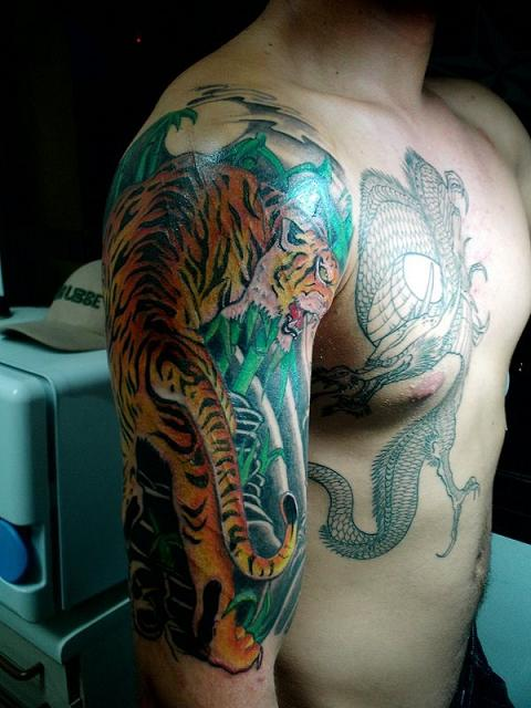 100 39 s of tiger and dragon tattoo design ideas pictures gallery for Panther tiger tattoo