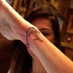 Women Cross Tattoo 9 150x150 - 100's of Wrist Tattoo Design Ideas Picture Gallery