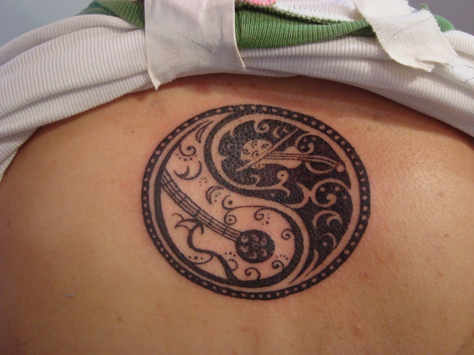 Yin Yang Tattoos Design Ideas Pictures Gallery