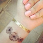 Daisy Tattoos 14 150x150 - 100's of Daisy Tattoo Design Ideas Picture Gallery