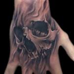 Skull Tattoo on hand 150x150 - 100's of Skull Tattoo Design Ideas Picture Gallery