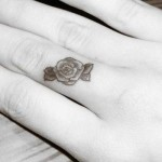 finger rose tattoo 150x150 - 100's of Rose Tattoo Design Ideas Picture Gallery