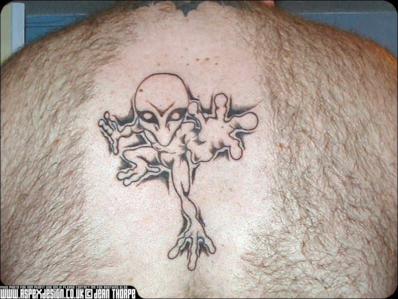 Outline Grey Ink Alien Tattoo On Back